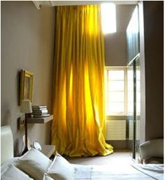 beige walls with yellow curtains
