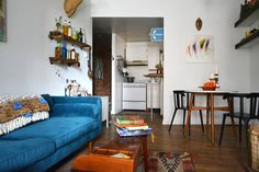 Strong textiles and a bold blue West Elm Monroe Mid-Century Sofa do a lot in a little bit of space.