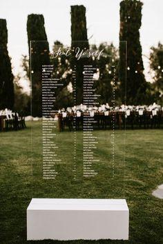 large acrylic diy seating plan at an outdoor wedding