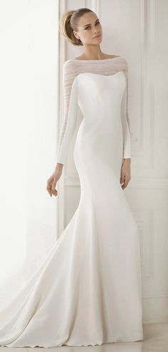 How to Save Big on Your Wedding: A Bride's Guide Pronovias 2015 Bridal Collection Pronovias 2015 Wedding Dress wedding dresses bridal gown bridal gowns sheath mermaid cut sheer sleeves long sleeves buttons modest Stunning Wedding Dresses, 2015 Wedding Dresses, Wedding Attire, Beautiful Gowns, Elegant Dresses, Bridal Dresses, Dress Wedding, Simple Dresses, Long Dresses