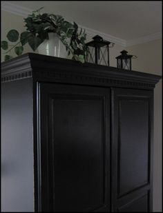 Painting the guest bedroom furniture black.