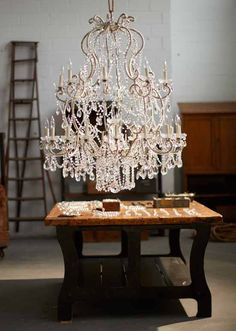 Ralph Lauren Home's hand-made Adrianna Chandelier draped in gently tumbled crystals.