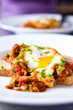 Baked eggs recipe- tomato, bacon, ramps and cheese on crusty bread