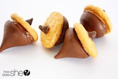 Kid friendly thanksgiving treats - acorns out of Hershey kisses, mini Nutter Butters, and mini chocolate chips