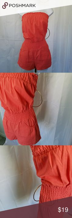 BODY CENTRAL STRAPLESS ROMPER NWT M VIBRANT CORAL STRAPLESS ROMPER by Body Central has elasticized smocking above the bust and at the waist. It has curved pockets on the front and patch pockets on the back. 100% linen. Super cute with a pair of thongs or sandals. Body Central Pants Jumpsuits & Rompers