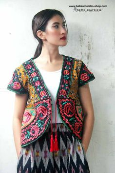Batik Amarillis's Garden Vest  This is when Indonesia's traditional textile :Tenun Batik Gedog Tuban meets Hungarian embroidery on black corduroy .This beautiful craftmanship features hand made tassel,pockets plus our signature Arcana in the back.