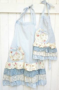 Very pretty Mommy and Me set of aprons in blue stripe with pretty floral ruffles. Mommy and me apron set. - Very pretty Mommy and Me set of aprons in blue stripe with pretty floral ruffles. Mommy and me apro - Ruffle Apron, Apron Dress, Cute Aprons, Sewing Aprons, Creation Couture, Apron Designs, Aprons Vintage, Linens And Lace, Mommy And Me