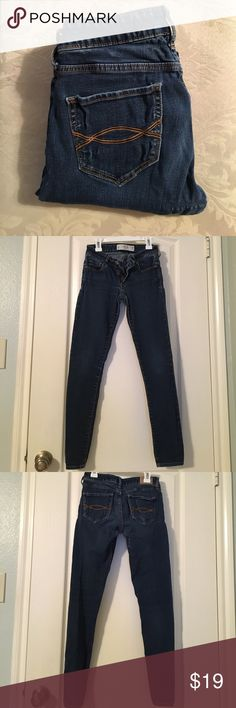 Abercrombie and fitch super skinny jeans Dark wash Abercrombie and fitch super skinny jeans. In worn condition as you can see by the closer up pictures near crotch and along the back. Pockets look stretched but it isn't very noticeable when being worn. They ARE A SHORT so inseam is 29 in as shown on tag. Feel free to ask any questions, offers are welcomed Abercrombie & Fitch Jeans Skinny