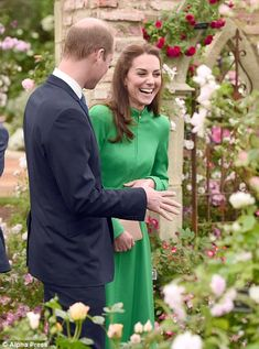 Kate grins by a romantic display...