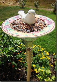 glue a vase to plate or bowl bottom & slip over stake....bird feeder or bird bath - now removable for washing