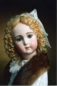 Antique doll with lovely face