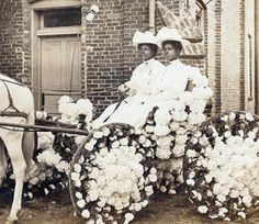 Women ride in a Juneteenth parade in Houston in 1900.