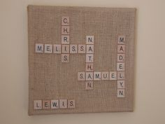 It's all the names in family spelled out in scrabble tiles. Each name intersects with at least one other. The letter tiles I purchased off of Amazon and the burlap board I found at Wal Mart (or you can cover a plain canvas with burlap). Wal Mart had many sizes and shapes, and I believe this one is 10″ by 10″. Each letter is just hot glued onto the burlap. One corner of the board looked a little empty, so I placed their last name in that spot by itself.