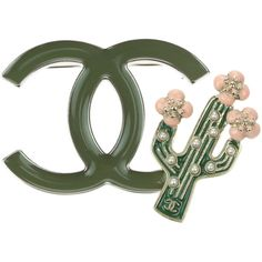 Pre-owned Chanel 17C Green Enamel CC Cactus Brooch (174.615 HUF) ❤ liked on Polyvore featuring jewelry, brooches, chanel, enamel jewelry, chanel broach, pre owned jewelry and chanel jewelry