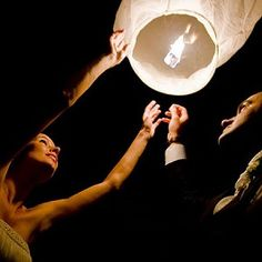 Chinese Lanterns are a must! Love the idea of having people write wishes on them before they send them off!