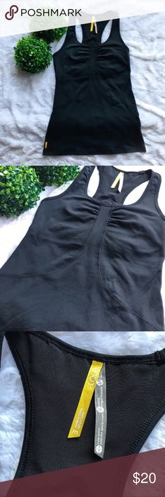 Lole Black Racerback Tank Top Lole black racerback tank top in excellent preloved condition. Size medium and 26 inches long. Features a built in shelf bra and a hidden side pocket. No flaws at all. I'm only looking to sell at this time so sorry but no trades. My listing price is firm. Lole Tops Tank Tops