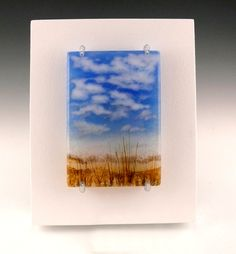 """Each glass particle painting is constructed of multiple layers of powders, grains and chunks of glass. The small particles are also known as """"frit"""", and the process can also be called """"frit painting"""" or """"painting with light"""""""