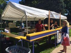 Sidewalk Day Sales booth for Rotary Club of Petoskey. Sell those Brats fellow Rotarians. That's a college scholarship for a high school student, a nursing student at North Central Michigan College or any other fine projects our club is involved in.