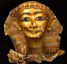 Egyptian smiling mummy mask. Late Dynastic Period.  '13 h x 15 w x 10 d inches. Very finely styled exempt with detailed designs in gold leaf and gesso on embossed linen. From Edgar L. Owen Galleries