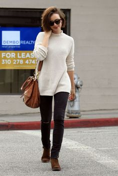 Lily Collins Beverly Hills street style, December 2014…Cream ribbed funnel neck jumper, black distressed skinny jeans, brown suede ankle boots, tan shoulder bag and tortoiseshell rim sunglasses. Celebrities out and about | celebrity fashion