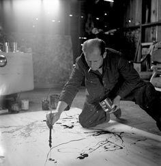 Jackson Pollock in his Long Island studio, 1949.  Photo by Martha Holmes—Time & Life Pictures/Getty Images.