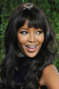 "Naomi Campbell - from Bazaar's ""Iconic Bangs Throughout History."" Try out the look with clip-on bangs from protahair.com made with Ultima hair."
