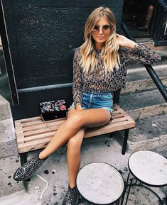 Shorts, leather booties and leopard print blouse make for a badass rock n roll chick style #booties #womensfashion