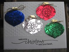 Stamps: Heard from the Heart Paper: metallic blue, silver, gold, red, green Ink: versafine onyx black Accessories: SU! ornament punch, CB and Sizzix efs, gold cording, scor-pal