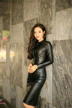 Pretty Asian girl in black leather dress
