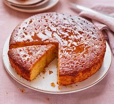 Add some citrussy zing to your baking with this orange olive oil cake, topped with a rosemary and cardamom drizzle. It's gluten-free and super delicious Rhubarb Orange Cake, Orange Drizzle Cake, Bbc Good Food Recipes, Baking Recipes, Cake Recipes, Delicious Recipes, Sweet Recipes, Vegan Recipes, Orange Olive Oil Cake