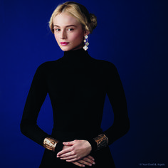 """Van Cleef & Arpels new """"Jewelry and Watches"""" catalog. Jackie-O cuff bracelets, yellow gold. Magic Alhambra four-motif earrings, yellow gold and white mother-of-pearl."""
