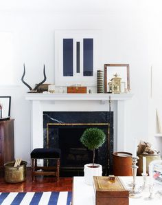 Fireplace with styled mantel and striped rug