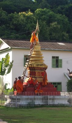 Monks working in one of the over 30 monasteries in Luang Prabang. Laos. Luang Prabang.