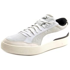 Enjoy the laidback appeal of these Alexander McQueen By Puma Women's 'MCQ Brace Femme Lo' Leather Athletic Shoes. Made from leather, these athletic shoes are available in grey. Leather/man-made materi