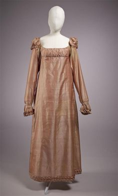 Dress of thin orange / yellow iridescent silk, long sleeves which short puff sleeves, sleeves and neckline trimmed with ruffles...circa 1815