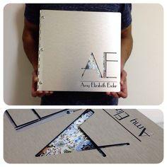 Custom graphic design portfolio book on brushed silver aluminum with cut-out and engraving treatment   da KloPortfolios.com