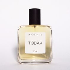 Maya Njie   Tobak Perfume: Tobak is a dark, pointed yet comforting scent composed of sweet smoky notes of Tobacco Leaf and Vetiver. Complemented with the warmth of animalic Musks and hints of Leather and Cinnamon.