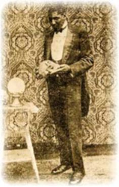 """""""BLACK HERMAN"""" Benjamin Herman Rucker (1892-1934), magician and illusionist born, was born in Amherst, Virginia. He was the most prominent African American magician of his time. He learned the art of stage illusions from a performer named Prince Herman, who was first his teacher and later his partner. Their show became a combination medicine show/stage. In 1909, Prince Herman died and Rucker, then only 17 years old, took the name Black Herman in honor of his friend.~photographer unknown."""