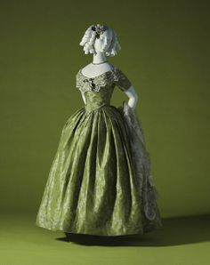 Evening dress  1845, unknown country Green silk brocade white floral pattern; two-piece dress; silk satin piping on bodice Kyoto Costume Institute