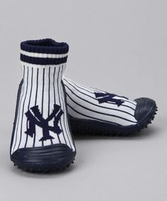 Major League Baseball calls for major league cute! These sock-like shoes are decorated with team spirit and feature nubby, slip-proof rubber soles to keep fans on their feet when cheering for a home run.
