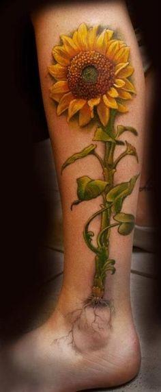 Leg tattoo with sunflower