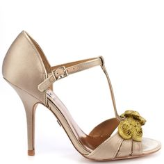 Bring old Hollywood back in this style from Badgley Mischka. Kamille has a beige satin upper and brings you a fanciful t-strap with an adjustable ankle strap and gold ribbon detail at the vamp. This style is complete with a 3 3/4 inch heel.