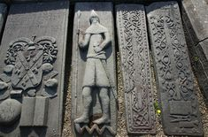 Kilmartin Church, Scotland. Sculpted gravestones dating back to medieval times, mixing Celtic art with images of knights.