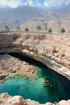 Oman Travel Inspiration - Sink Hole in Oman. Watch a video about this on PBS a couple weeks ago. They make excellent time capsules for the Earth because the lack of oxygen preserves bones well. Places To Travel, Places To See, Travel Destinations, Places Around The World, Around The Worlds, Sultanate Of Oman, Oman Travel, Brunei, Wonders Of The World