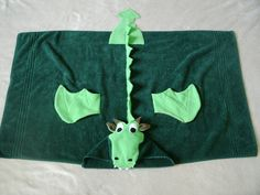 This fun dragon hooded towel will make bathtime or pool time a blast! The towel is a regular full-sized 30 x 50 towel (not including the hood), so its Sewing Kids Clothes, Sewing For Kids, Baby Sewing, Fabric Crafts, Sewing Crafts, Sewing Projects, Finger Puppet Patterns, Hooded Bath Towels, Sewing To Sell