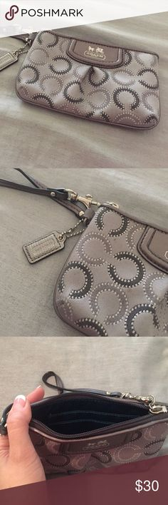 "💯Authentic coach pouch wristlet🐶 Authentic coach silver circle pouch the dimensions are 6 1/2"" x 4"" Coach Bags Clutches & Wristlets"