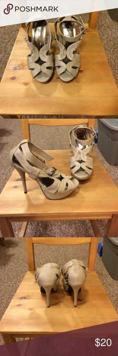 Gray Anne Michelle platform heels Adorable gray heels with very high heels and a short platform. Straps buckle around the ankles. These are very very cute! Anne Michelle Shoes Heels