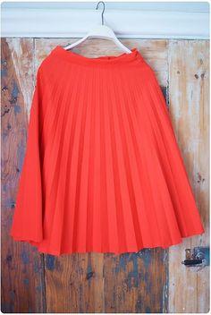 Red pleaded skirt