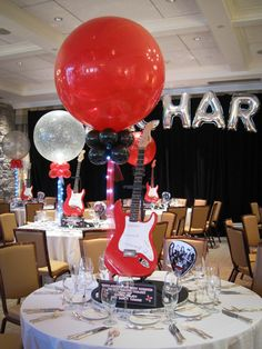 Real Guitar Music Centerpiece with Alternating Red & Sparkle Balloons, I like the pick on the table too.