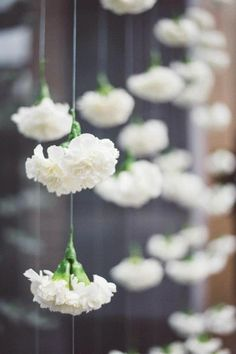 Fake flowers get a totally different look when hung from fishing line or wire in a window display.Hang from ceiling and windows in shed